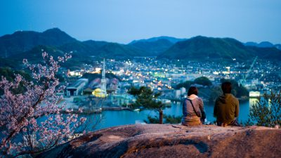 Landscape view of Kurashki city and Takahashi River at night. Hanami (Sakura blooming season). Okayama Prefecture. Japan.